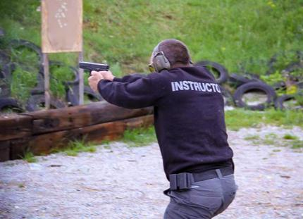 Instructor demonstrates dynamic pistol shooting at training ground in Bulgaria