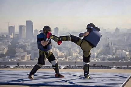 Two Israeli special forces officers practice hand-to-hand combat during a training course