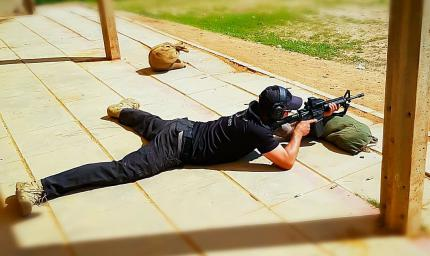 A cadet of the FEDERAL PERFORMANCE SERVICE in a lying position fires with an M16 assault rifle at the training ground in Israel